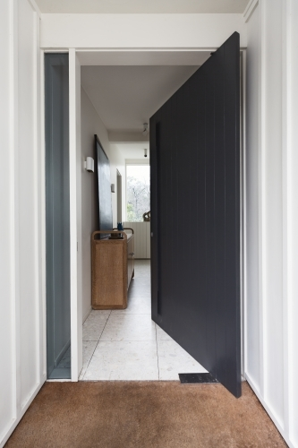 Open front pivot style door to a luxury Australian home