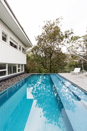 Contemporary fully tiled swimming pool in mid century modern Australian home