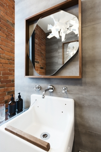 Close up of vintage style bathroom vanity in renovated warehouse apartment
