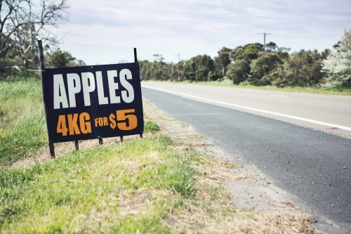Roadside sign advertising fresh apples for sale ahead horizontal