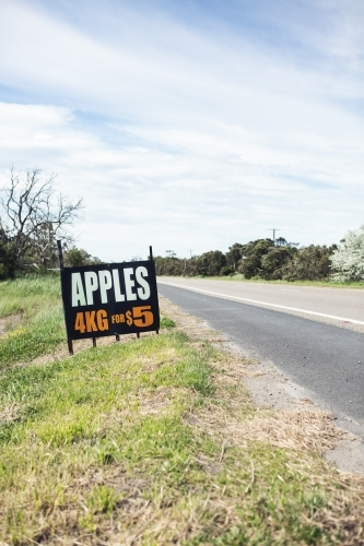 Roadside sign advertising fresh apples for sale ahead vertical
