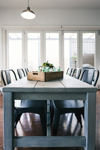 Vintage bottle crate decor in an industrial styled dining room