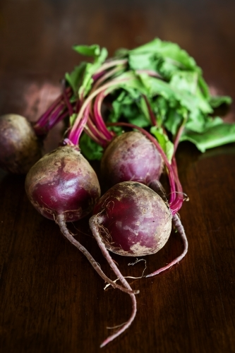 Group of whole beetroot vegetable on a wooden table