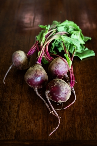 Overhead view of raw beetroots with leaves left on