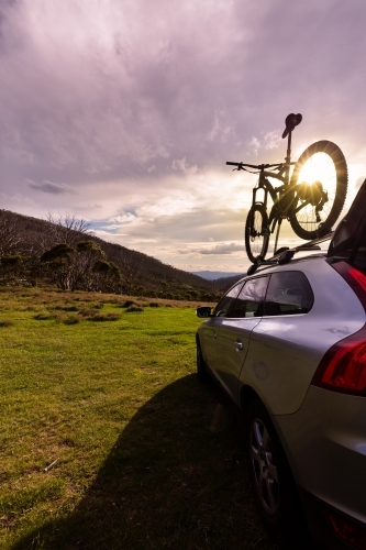 Mountain bike and SUV at sunset at Dead Horse Gap