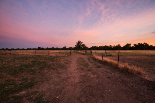 Colourful sunrise landscape of farming paddocks