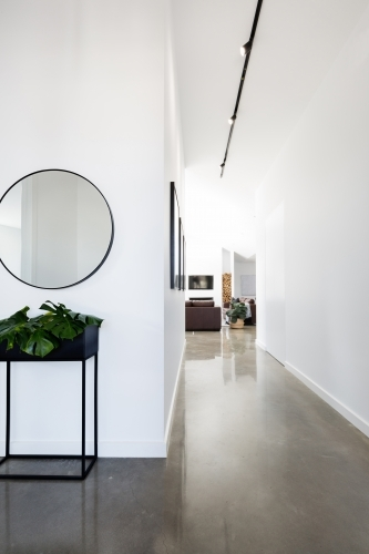 Contemporary new home entry with polished concrete floors