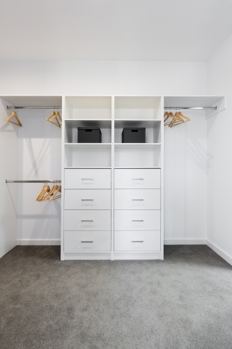 Large walk in wardrobe cabinetry detail