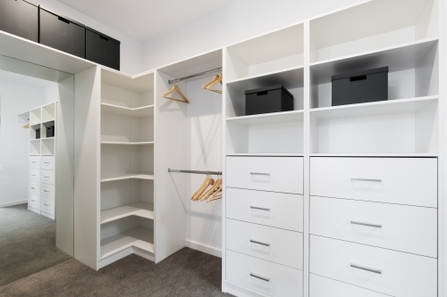 White built in storage in large walk in wardrobe