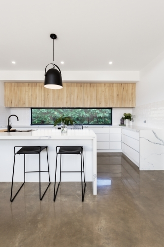 Luxury kitchen with carrara marble waterfall island bench