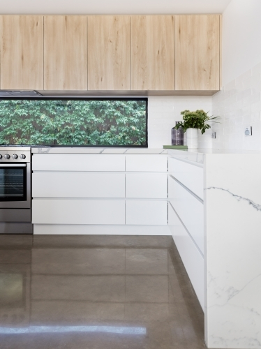 Kitchen details of concrete floor and oversized soft close drawers