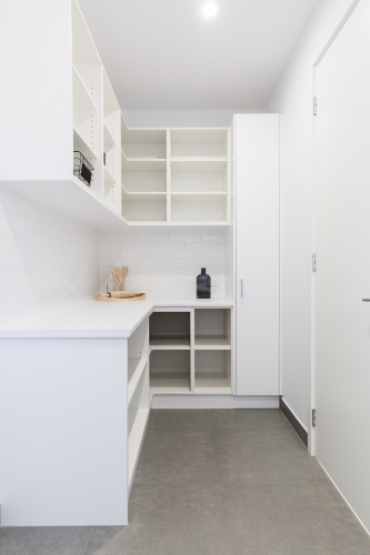 Large walk in butlers pantry storage area in a new home