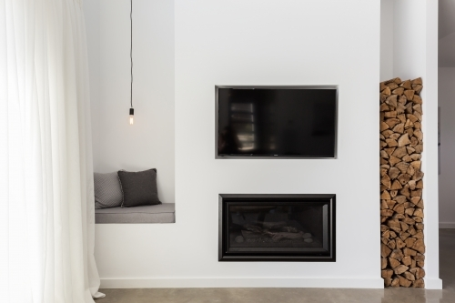 Built in tv and gas fire in a contemporary living room