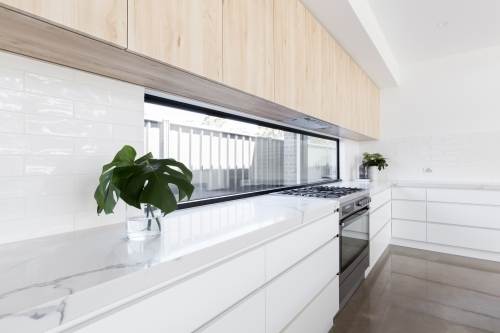 Modern luxury kitchen with window splashback