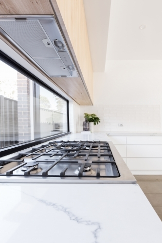 Close up of gas cooktop in a contemporary new kitchen