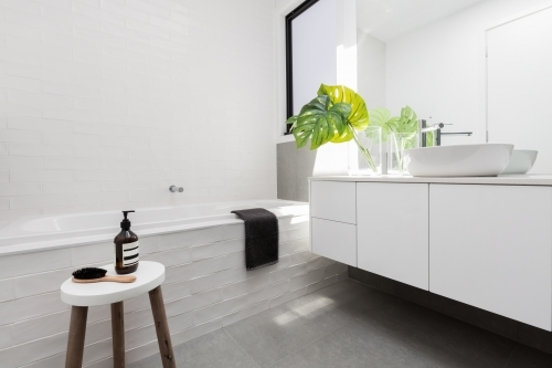 Stylish family bathroom of white scandinavian theme