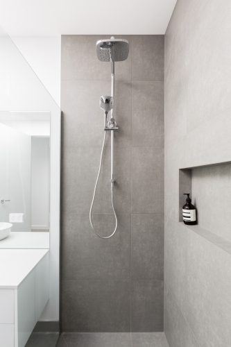 Luxury fully tiled shower with rain head and hand held shower rose
