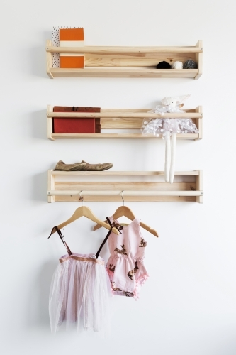 Pretty toys shelf storage in a young girls bedroom