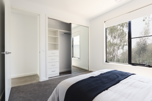 Mirrored wardrobe detail in a bedroom with a view