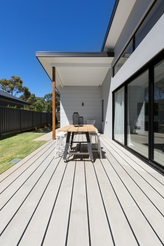 Large outdoor decking and high entertaining  table in a new home