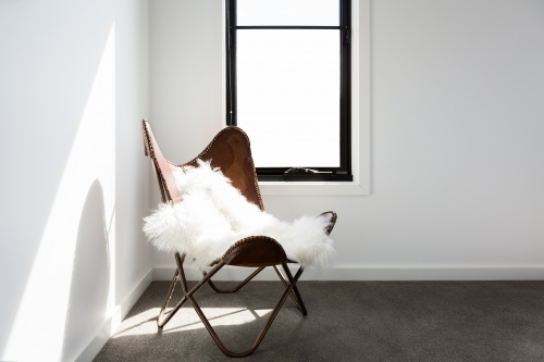 Gorgeous leather occasional chair with scandi style sheepskin