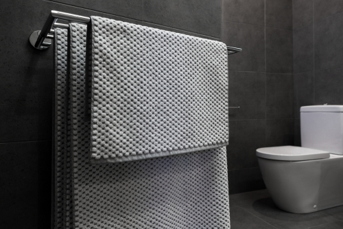 Close up of luxury bathroom towels in a monochrome ensuite