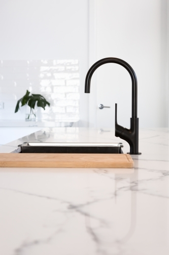 Gooseneck black tapware in a stunning white kitchen