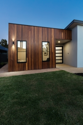 Vertical contemporary new home with wood cladding detail