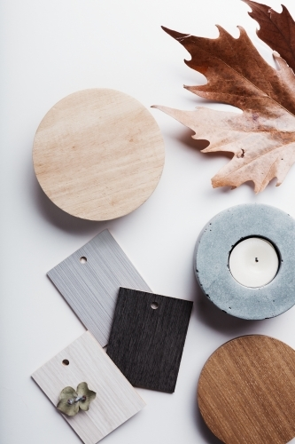 Flat lay of autumn grey and warm tone interior finishes objects