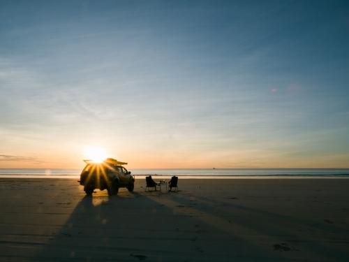 4WD on Cable Beach Next to Two Chairs