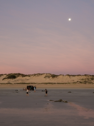4WD on Cable Beach with Moon in Background