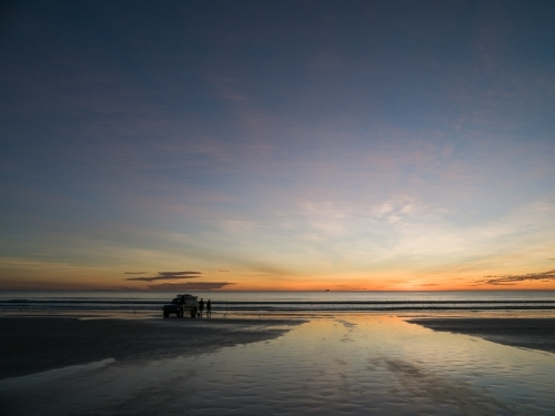 4WD Parked on Cable Beach with Two People