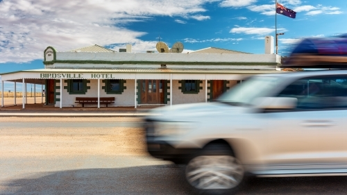4wd passing the Birdsville Hotel