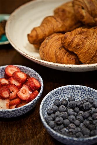 A breakfast selection of croissants, strawberries and blueberries