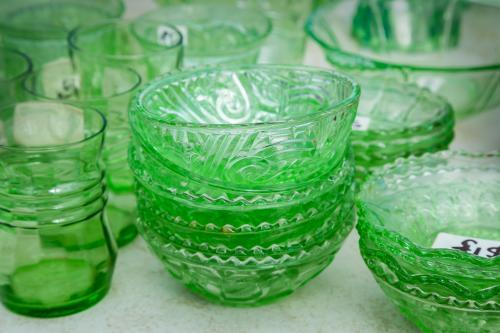 A collection of green glass crockery
