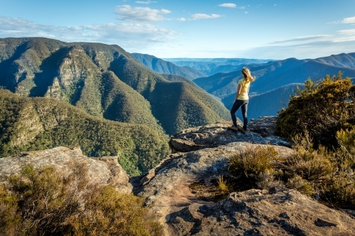 A female hiker exploring some of the wildest mountains Australia