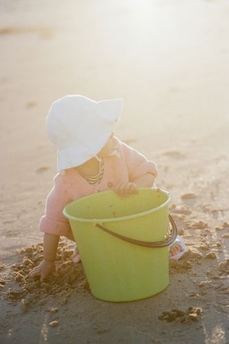 A Little Toddler Playing with Sand at the Beach