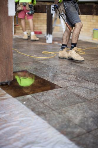 A reflection of a tradesman working on home renovations.