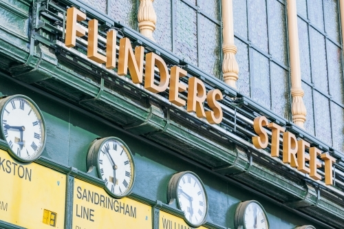 A row of old fashioned railway clocks at Flinders Street Station in Melbourne