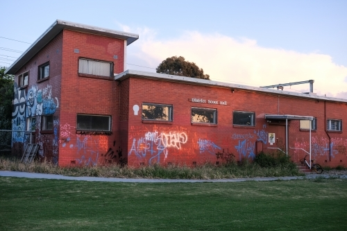 A scout hall covered in graffiti