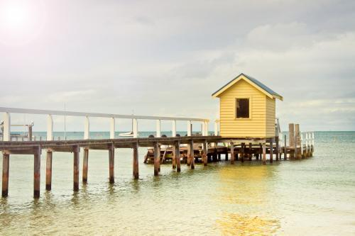 A small shed on the end of a jetty