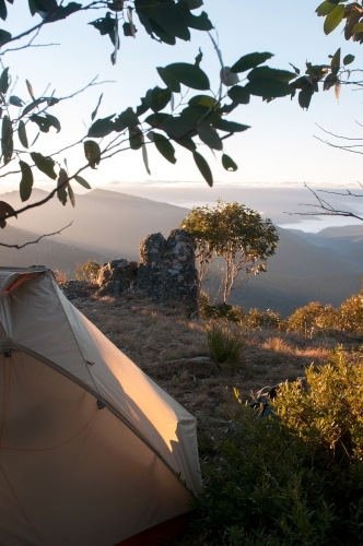 A tent and camp overlooking mountain range