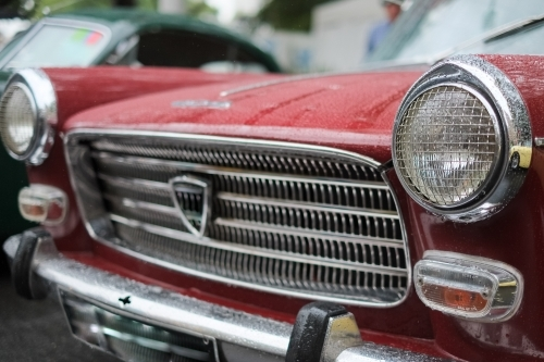 a vintage car headlights and grills on display