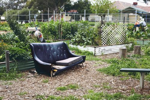 Old lounge in a public self sustainable veggie garden