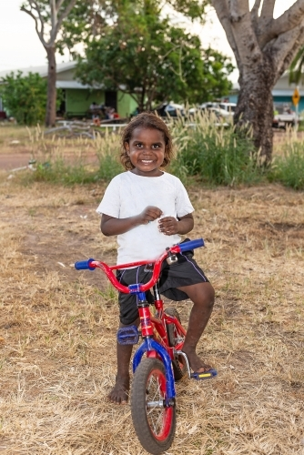 Aboriginal boy on bike