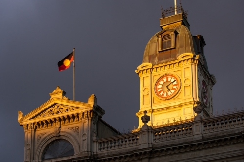 Aboriginal flag flying above a heritage building