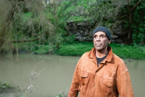 Aboriginal Man in his Forties Standing by River