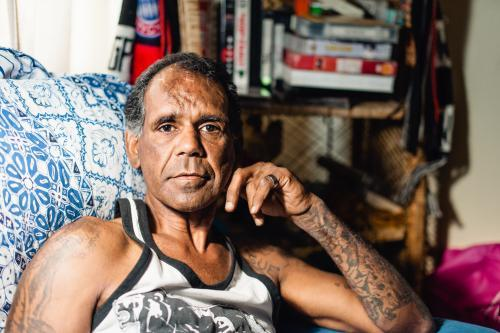 Aboriginal Man Seated in Loungeroom