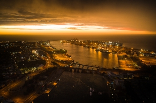 Aerial image of a port after sunset