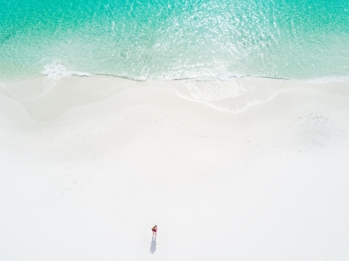 Aerial image of woman on idyllic perfect beach